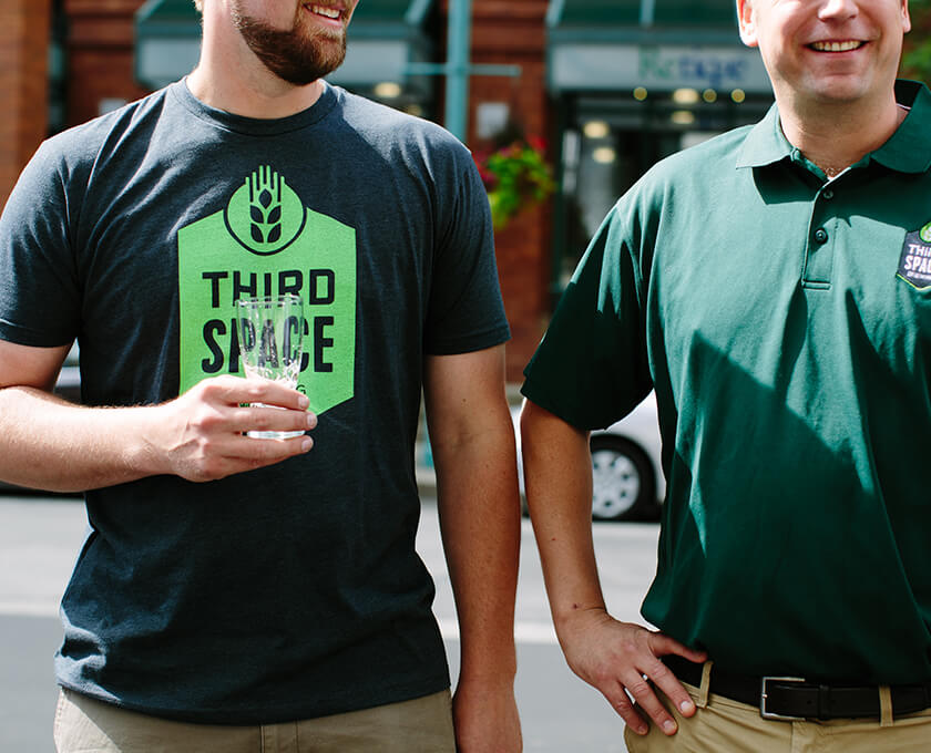 Third Space Brewmasters wearing branded shirts